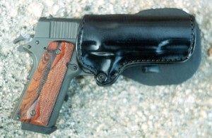 This time, the gun is wearing grips by Esmeralda and is carried in a Gunleather, Inc holster. Enough to melt the heart of any 1911 fan.